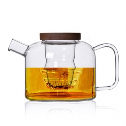 Glass tea pot with wooden lid